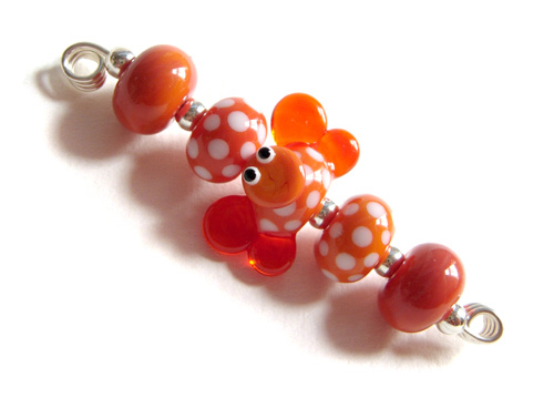 Brenda the butterfy in coral sunny mango handmade lampwork glass beads